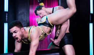 In a futuristic sex play space, Beaux Banks is passionate for dick and when Roman Todd thongs him upside down with his legs in the air, Beaux is in co
