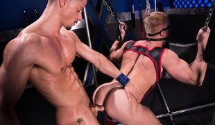 Skyy Knox and Johnny V make out passionately in anticipation of Skyy takes control and throws Johnny in a sling with a blindfold on