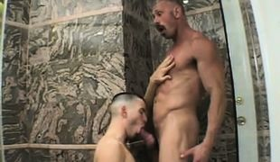 Cute twink serves silver dad in douche