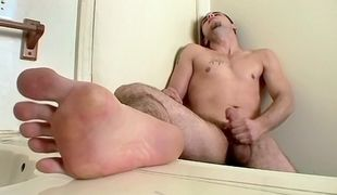 Sporty Cage releases his stinky feet and his juicy cock for a jack-off show