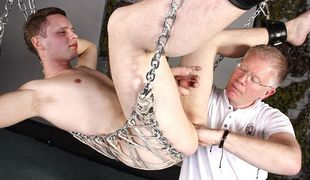 Twink ass slave Aiden gets his soft hole fisted and his cock jerked to climax!