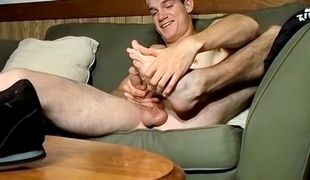 Straight sporty boy Glock reveals his feet and strokes out some hot cum