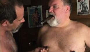 Lusty old gays caress nipples with cigar