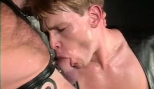 Young gay in leather sucks cock of bear dilf