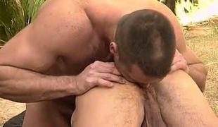 Bear dilf licks out hairy males hole in tropic forest