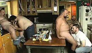 Chubby mature gays suck cocks on kitchen