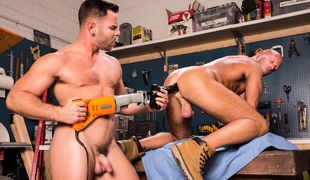 Nick Sterling is stroking his appliance in the workshop, watching some porn on his phone