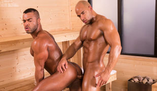 Micah Brandt sits down next to Sean Zevran in the sauna