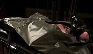 The prisoner is ordered inside a claustrophobic bodybag with a gasmask
